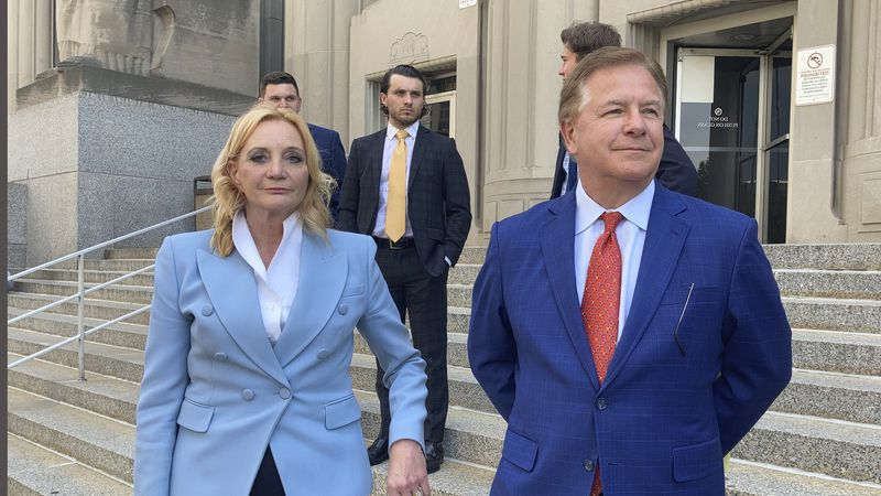 Patricia McCloskey, left, and her husband Mark McCloskey leave a court in St. Louis, Thursday,...
