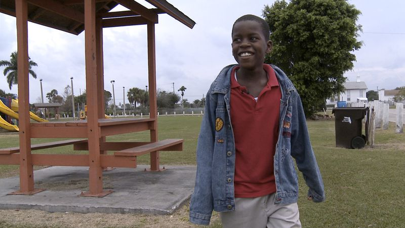 FILE - In this Jan. 13, 2009 file photo, Damon Weaver, 10, walks in a park near his home in...