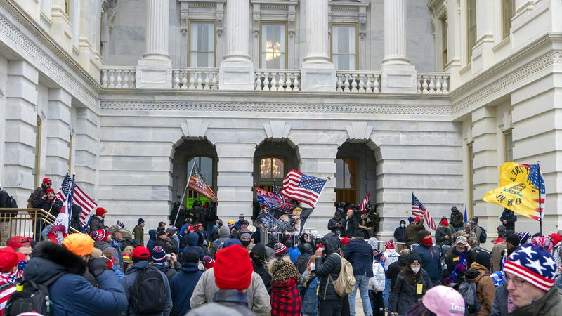 Supporters of President Donald Trump try to open a door of the U.S. Capitol on Wednesday, Jan....