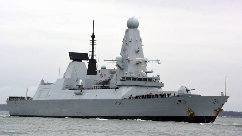 FILE - This March 20, 2020 file photo shows HMS Defender in Portsmouth, England. The Russian...
