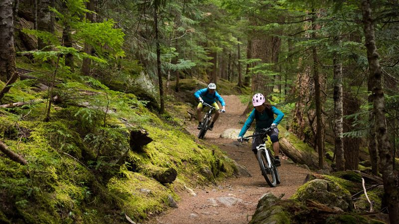 Mountain bikers weaving through rocky terrain