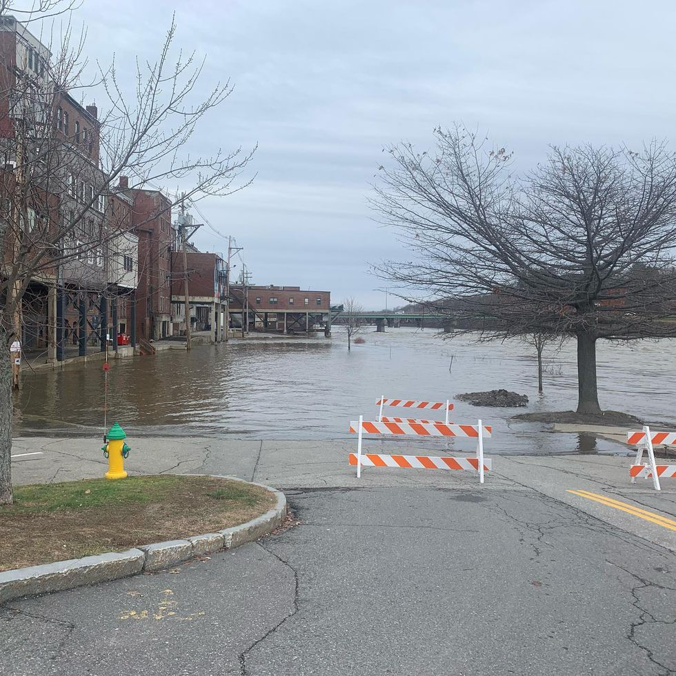 Augusta Public Works crews keeping the north end of Front Street closed until river returns to...