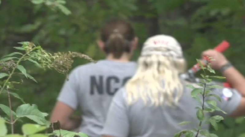 A team of Americorps workers is pitching in to clear some new trails in Central Maine.