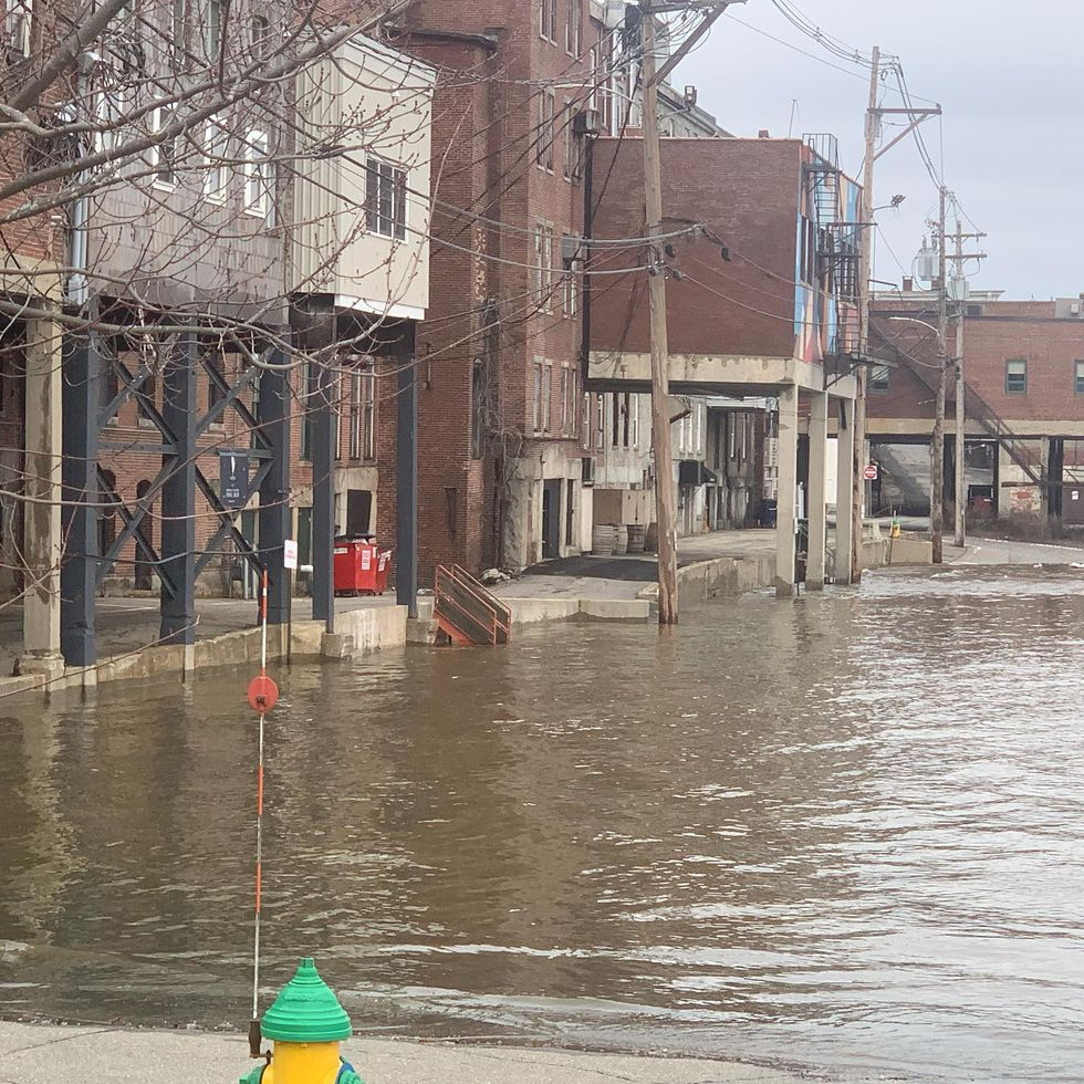 Front Street in Augusta flooded after rising river levels from the Christmas Day storm spilled...