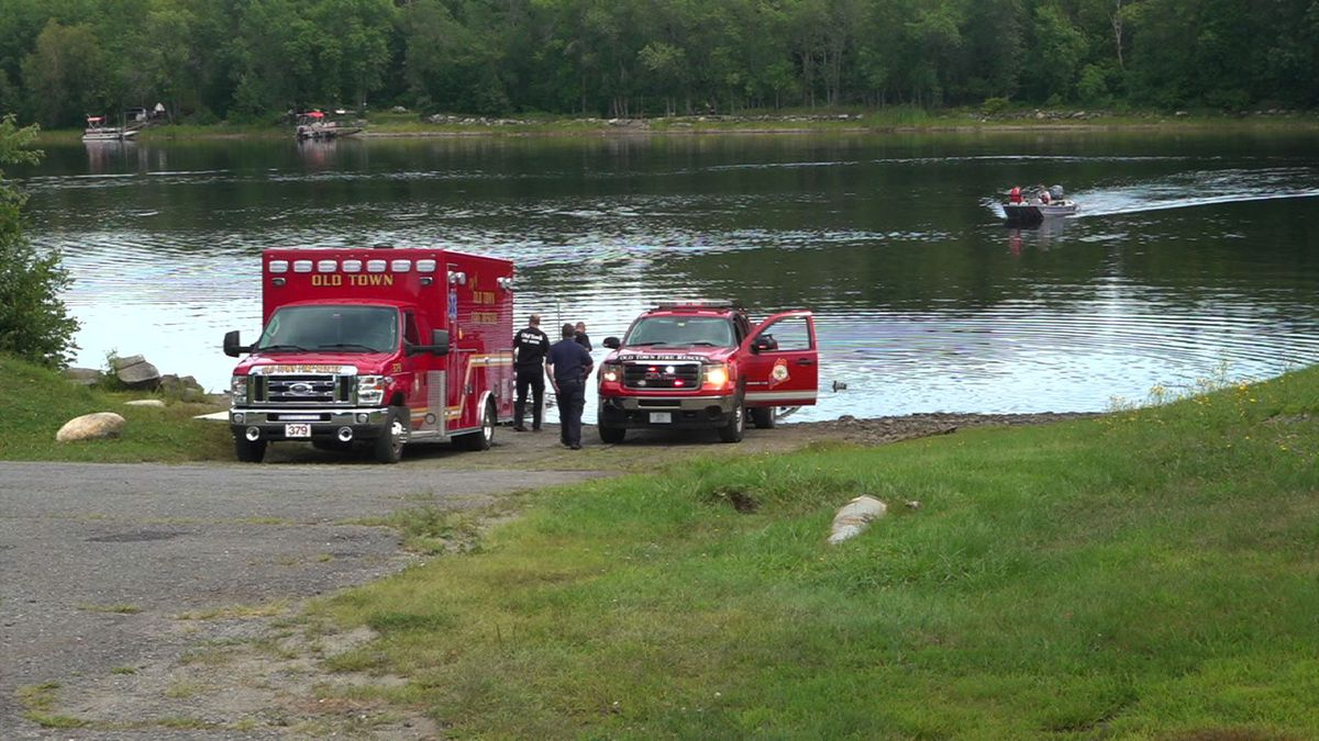 Law enforcement involved in water rescue on Penobscot River.