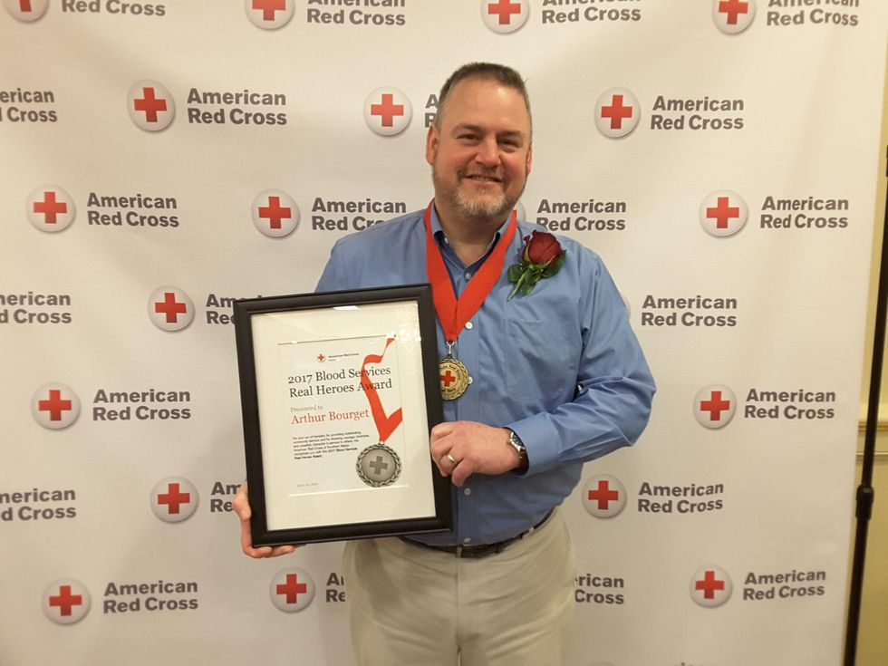 Arthur Bourget receives 2017 award from Red Cross.