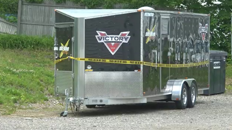 Crime scene tape currently surrounds a trailer located at 129 Center Street.