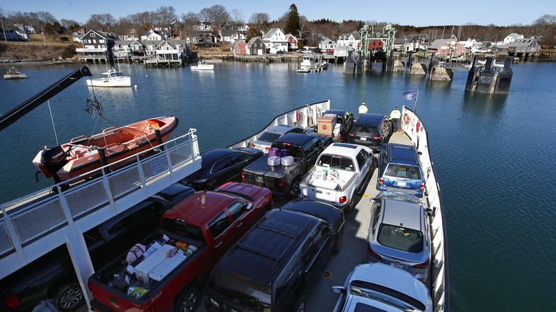 An automobile ferry arrives at North Haven, Maine, Monday, March 16, 2020.  (AP Photo/Robert F....