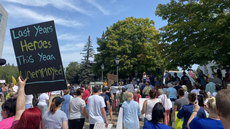 Hundreds gather for health care workers vaccine mandate protest.