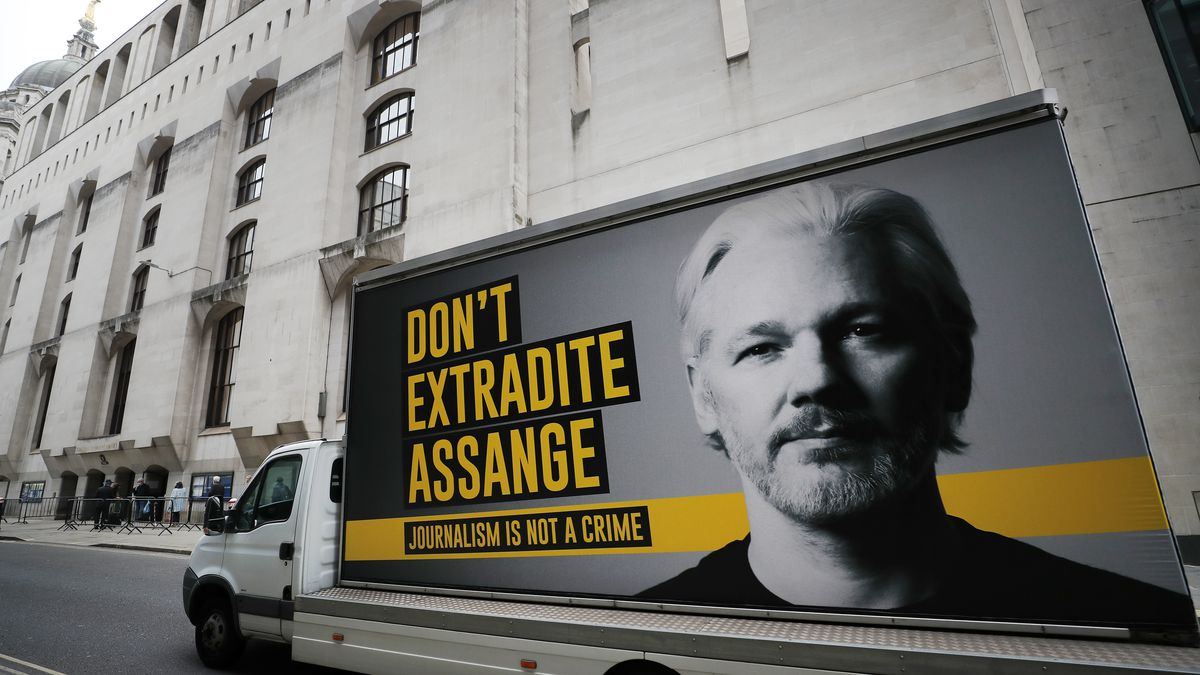 A truck with a billboard of Julian Assange arrives at the Old Bailey court in London, Monday, Sept. 21, 2020 as his extradition hearing to the US continues.