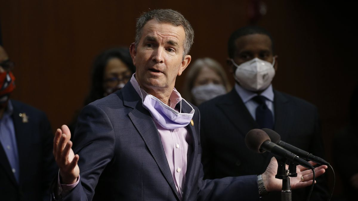Virginia Gov. Ralph Northam speaks during a news conference in June that Virginia has rolled out a smartphone app to automatically notify people if they might have been exposed to the coronavirus.