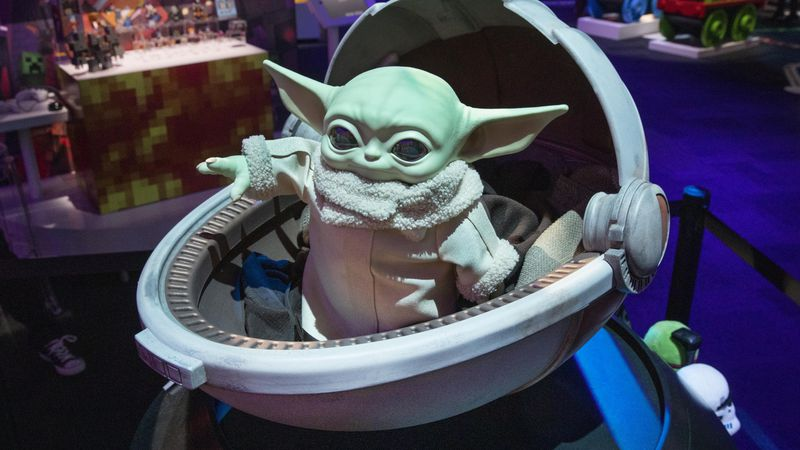 A Baby Yoda doll, by Mattel, is displayed at Toy Fair New York, in the Javits Convention...