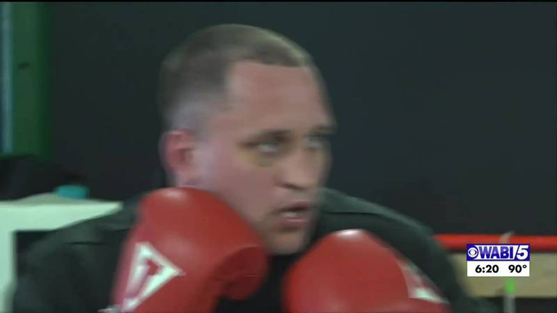 Local fighter Rolfe earns championship belt