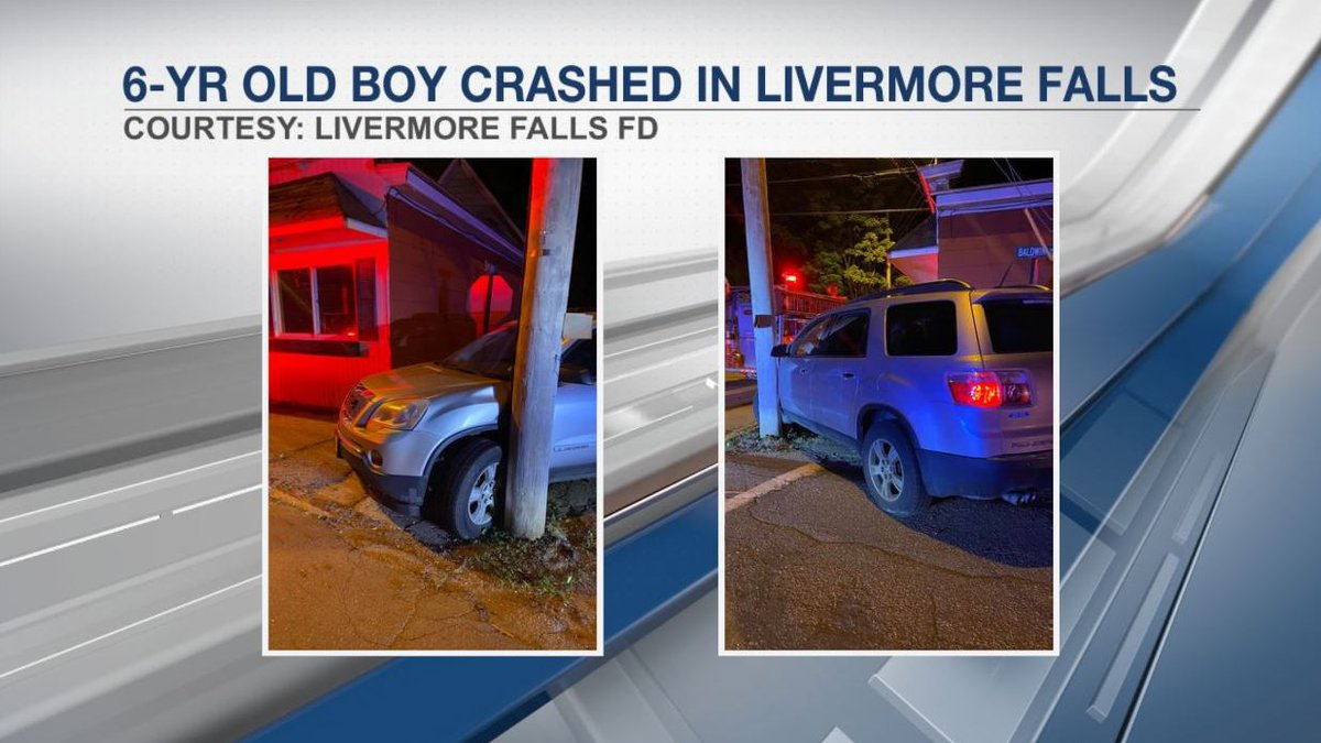 The SUV got stuck between a utility pole and a building.