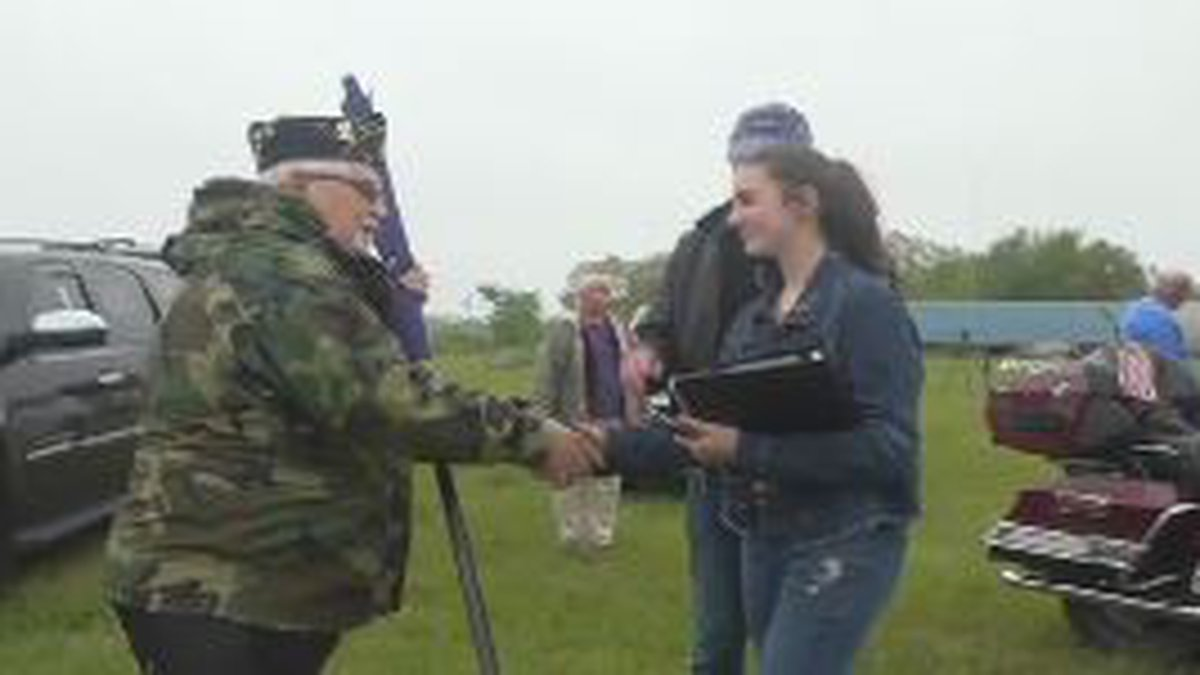 13-year-old Bella Kippen is collecting veterans' signatures to frame with her flag.