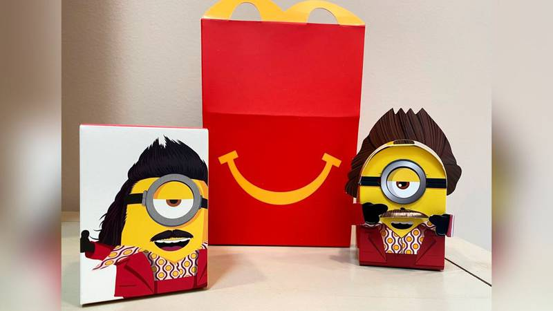 A cardboard McDonald's Happy Meal toy is shown with a Happy Meal box on Sept. 20, 2021....