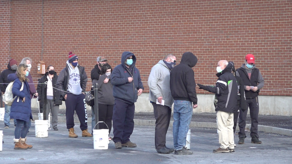 Waterville voters wait in line at polling center.