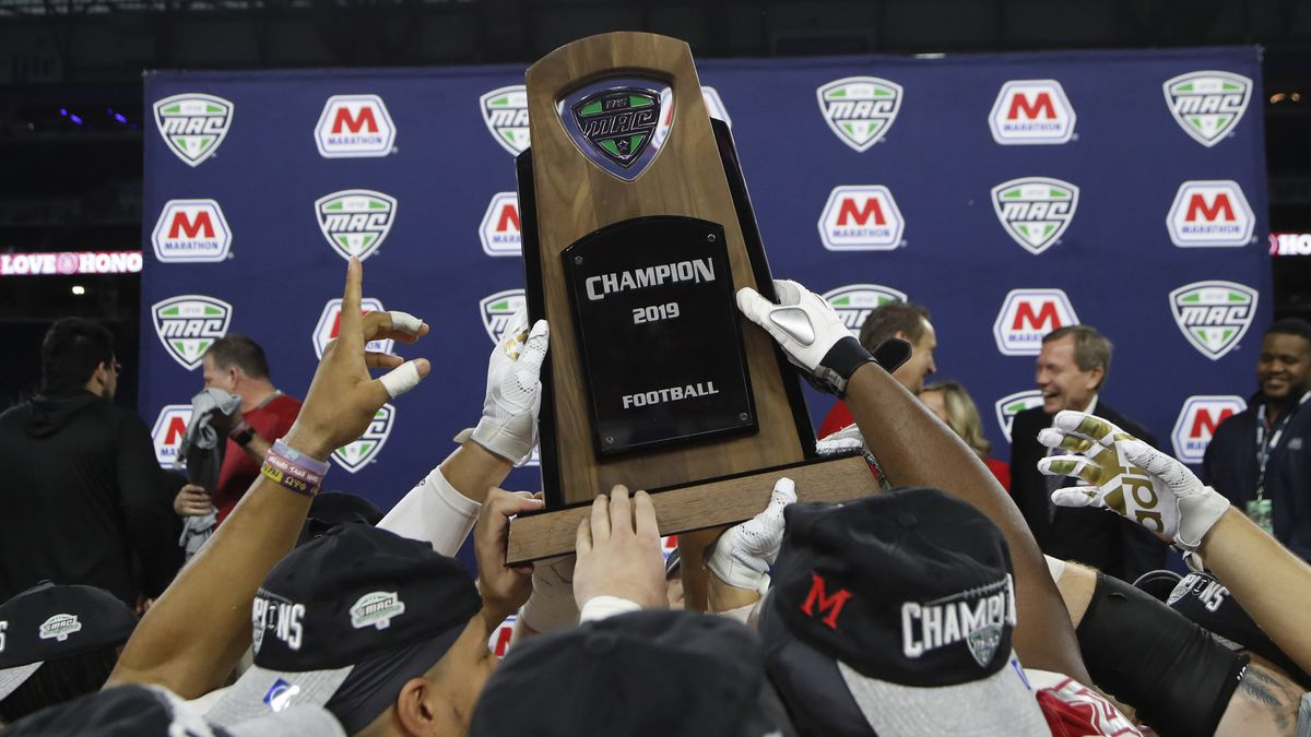 FILE - In this Dec. 7, 2019, file photo, members of the Miami of Ohio team hold the champion trophy after the Mid-American Conference championship NCAA college football game against Central Michigan, in Detroit. The Mid-American Conference on Saturday, Aug. 8, 2020, became the first league competing at college football's highest level to cancel its fall season because of COVID-19 concerns. With the MAC's 12 schools facing a significant financial burden by trying to maintain costly coronavirus protocols, the conference's university presidents made the decision to explore a spring season.