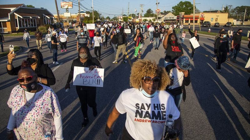 Demonstrators march peacefully in Elizabeth City, N.C., Monday April 26, 2021, after family...