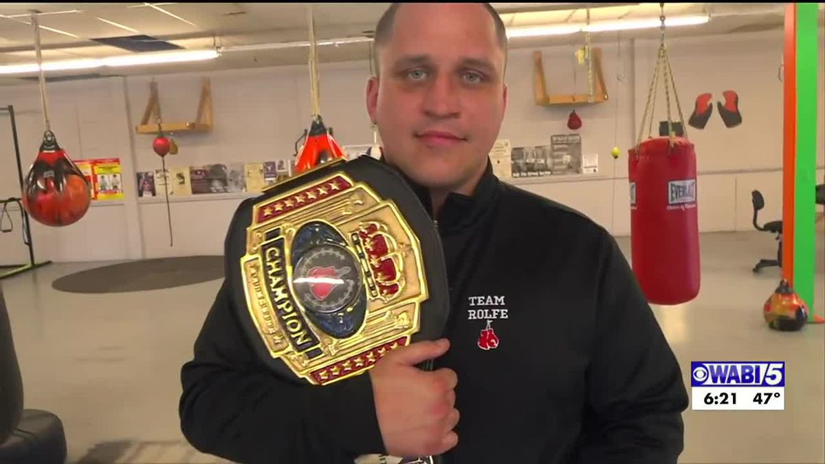 North Anson Native Justion Rolfe puts his recently won New England Heavyweight title on the...