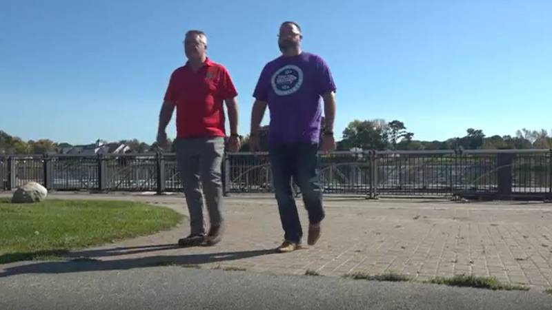 Mike Vittum and Jamey Kenneson take a walk along the Bangor Waterfront Thursday. The two are on...