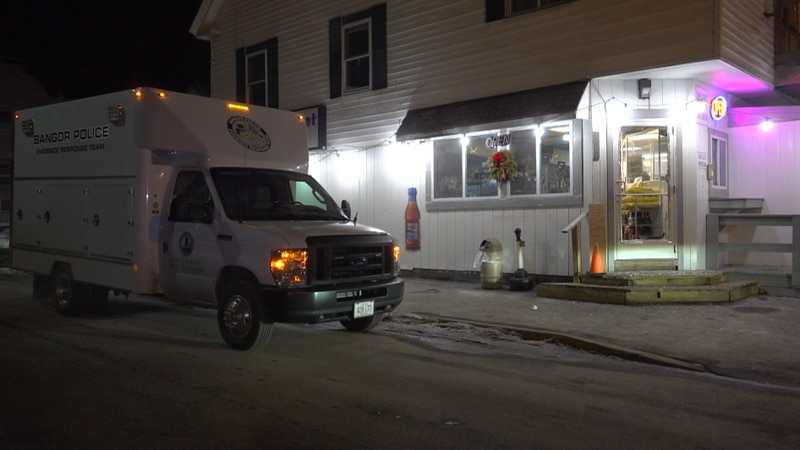 Bangor Police Evidence Response truck parked outside of Joe's Market early Tuesday morning