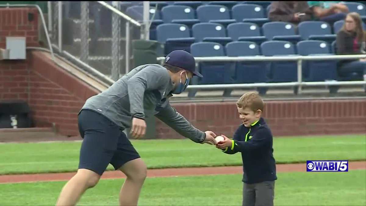UMaine head hockey coach Barr throws out first pitch at Sea Dogs game